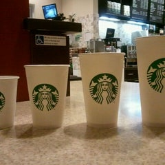 Photo taken at Starbucks by Paolo F. on 4/11/2011