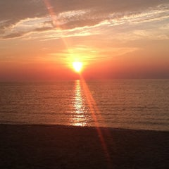 Photo taken at Southold Beach by Letisia C. on 7/24/2011
