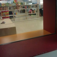 Photo taken at Queens Central Library by Tahirah on 9/30/2011