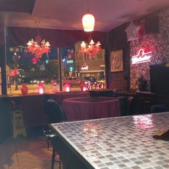 Photo taken at Dragon Lady Lounge by Richard T. on 4/7/2012