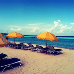 Photo taken at Country Country Beach Cottages Negril by Erin D. on 6/26/2012