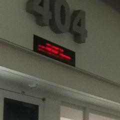 Photo taken at Gate 404 by Ashlee B. on 8/21/2012