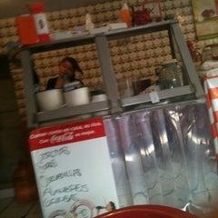 Photo taken at Los Cuñados by Erika N. on 8/4/2012