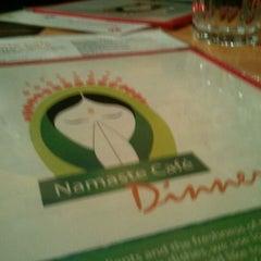 Photo taken at Namaste Cafe by Ben G. on 12/14/2011