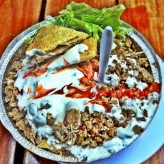Photo taken at The Halal Guys by Aj A. on 8/26/2012