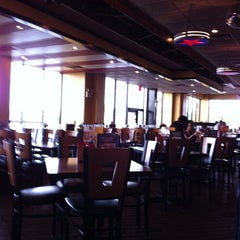 Photo taken at T.G.I. Friday's by Naimah W. on 5/11/2011