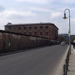 Photo taken at Baudenkmal Berliner Mauer   Berlin Wall Monument by Cassio D. on 4/18/2012