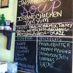 Photo taken at Pom Pom's Teahouse & Sandwicheria by J C. on 8/1/2012