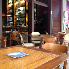 Photo taken at Esch Café by Milene Ester C. on 4/10/2012