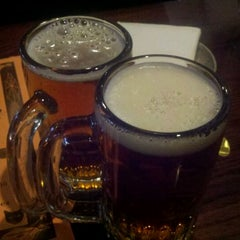 Photo taken at Pub Dog Pizza & Drafthouse by Adam on 10/7/2011