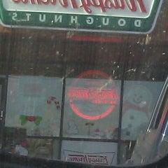 Photo taken at Krispy Kreme Doughnuts by Jennifer B. on 12/11/2011
