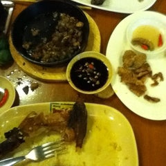 Photo taken at Mang Inasal by Michael S. on 3/14/2012