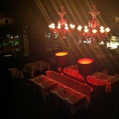 Photo taken at Society Dining Lounge by Irina G. on 9/9/2012