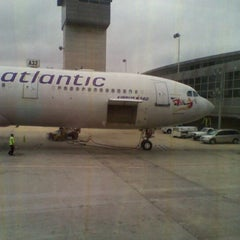 Photo taken at Gate A32 by Manco C. on 4/9/2011