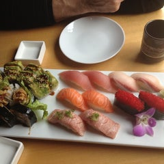Photo taken at Symphony Sushi by Becca S. on 4/1/2012
