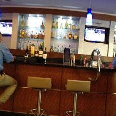Photo taken at Delta Sky Club by Sean M. on 5/2/2012