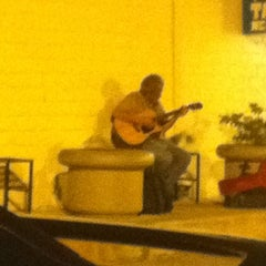 Photo taken at Old Guy Playing Guitar by Loral F. on 7/3/2011