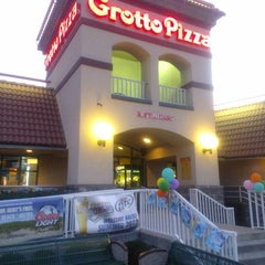 Photo taken at Grotto Pizza by Gavin T. on 7/12/2012
