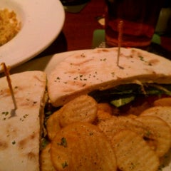 Photo taken at The Lion & Rose British Restaurant & Pub by Michelle R. on 2/17/2012