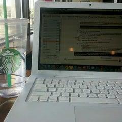 Photo taken at Starbucks by Jessica F. on 7/12/2012