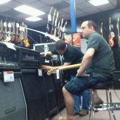 Photo taken at Guitar Center by HERNAN P. on 3/18/2012