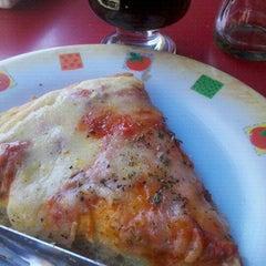 Photo taken at Pizzeria Mi Tio by Karla L. on 12/31/2011
