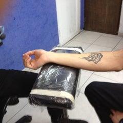 Photo taken at Evolution Tattoo by SaMm SaNDovaL on 8/4/2012