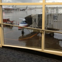 Photo taken at Gate B12 by Scott H. on 3/20/2012