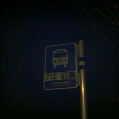 Photo taken at 712 Bus Stop by Christian M. on 3/12/2012