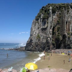 Photo taken at Praia da Guarita by Josi Hellem V. on 2/20/2012