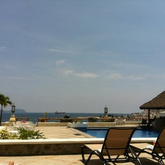Photo taken at Villas del palmar by Paola V. on 7/31/2012