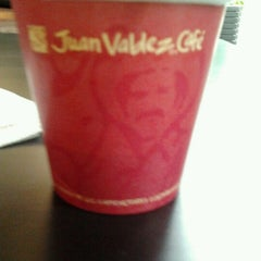 Photo taken at Juan Valdez Café by Daniela R. on 1/23/2012