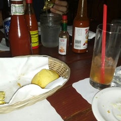 Photo taken at Stevie's Creole Cafe & Bar by Candice G. on 9/1/2012