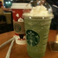 Photo taken at Starbucks by Sofyan D. on 12/17/2011
