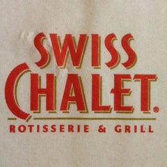 Photo taken at Swiss Chalet by Lana S. on 7/19/2012