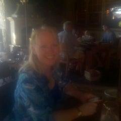 Photo taken at Boca Steak & Seafood by Caren G. on 10/13/2011