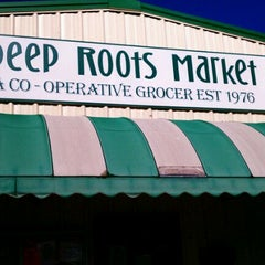 Photo taken at Deep Roots Market by Jacqueline H. on 12/17/2011