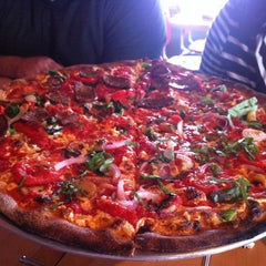 Photo taken at Tucci's Fire N Coal Pizza by Christopher H. on 3/4/2012