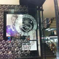 Photo taken at American Tattoo (Bond Street) by Diego R. on 3/5/2012