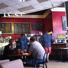 Photo taken at New Moon Cafe by Jess H. on 3/25/2012