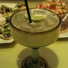 Photo taken at Yolös Mexican Grill by Kerri C. on 3/11/2012