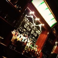 Photo taken at Dublin's Irish Pub by Alex R. on 3/26/2012
