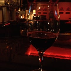 Photo taken at The Office Restaurant & Lounge by Eric on 7/12/2012