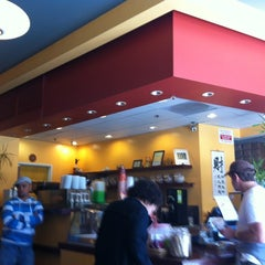 Photo taken at Infuzion Cafe by Jeannie N. on 4/6/2012