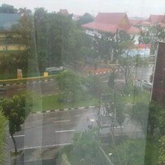 Photo taken at Jalan Jenderal Sudirman by Ryan J. on 12/19/2011