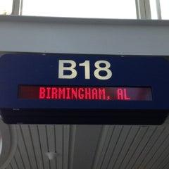 Photo taken at Gate B18 by Erin B. on 6/22/2012