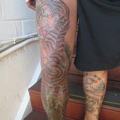 Photo taken at Electric 13 tattoo by Mark M. on 2/3/2012