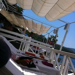 Photo taken at Nur Beach by Cem G. on 6/26/2012
