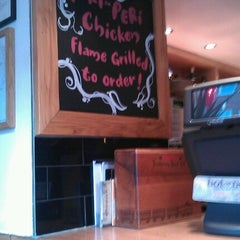 Photo taken at Nando's by Mark H. on 7/11/2012