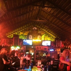 Photo taken at The Hut Bar and Grill by Marty E. on 2/20/2012